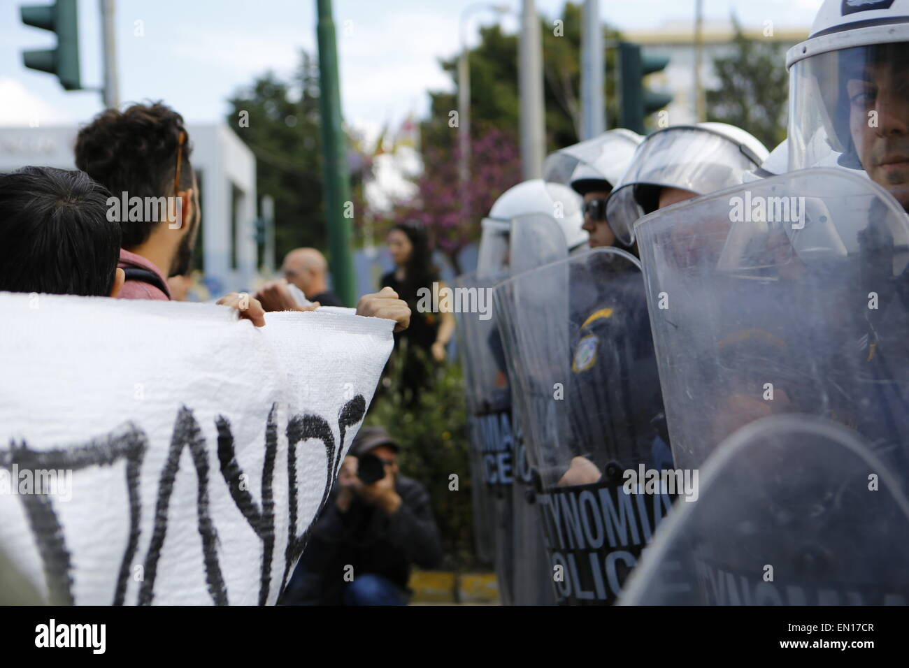 Athens, Greece. 25th Apr, 2015. Pro-immigration protesters and riot police officers face each other outside the - Stock Image