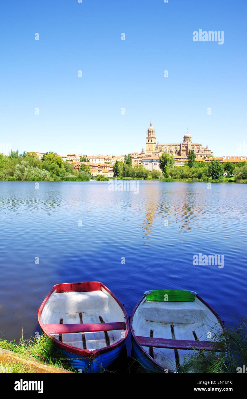 boats at Tormes river, in front of the Cathedral of Salamanca - Stock Image