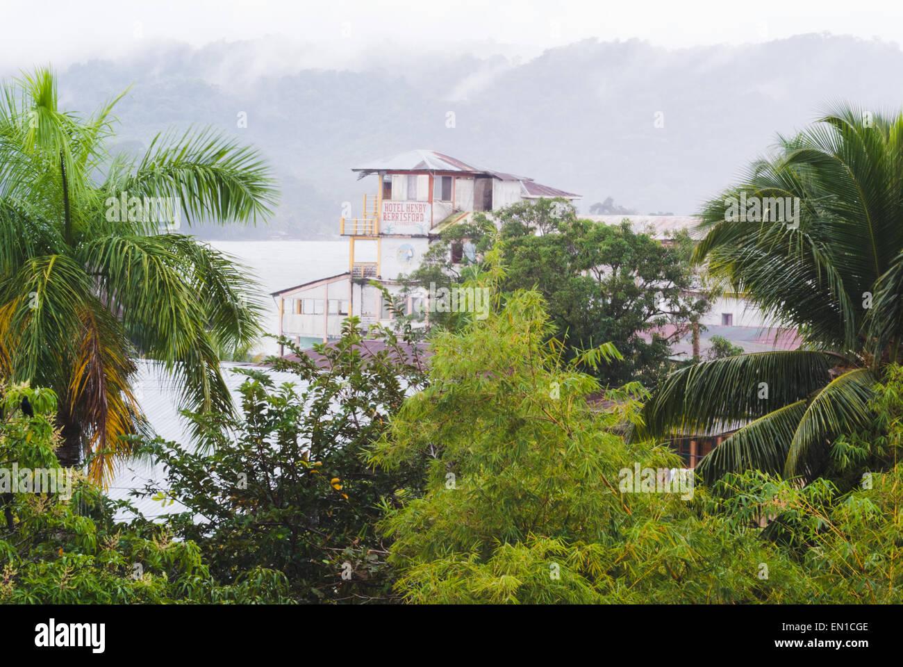 Tropical rainstorm on the Rio Dulce, Livingston, Guatemala - Stock Image