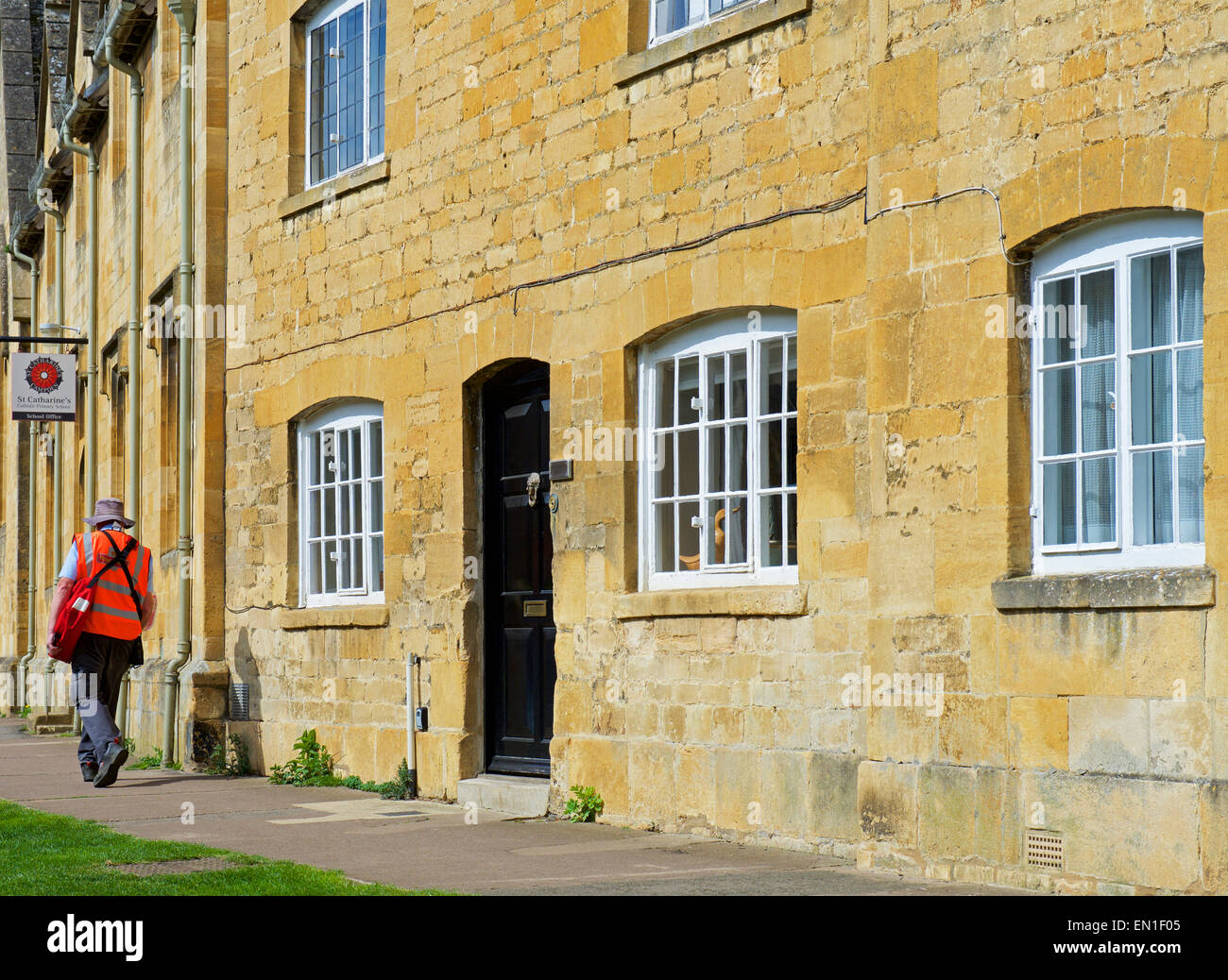 Postman delivering mail in Chipping Campden, Gloucerstershire, Cotswolds, England UK - Stock Image