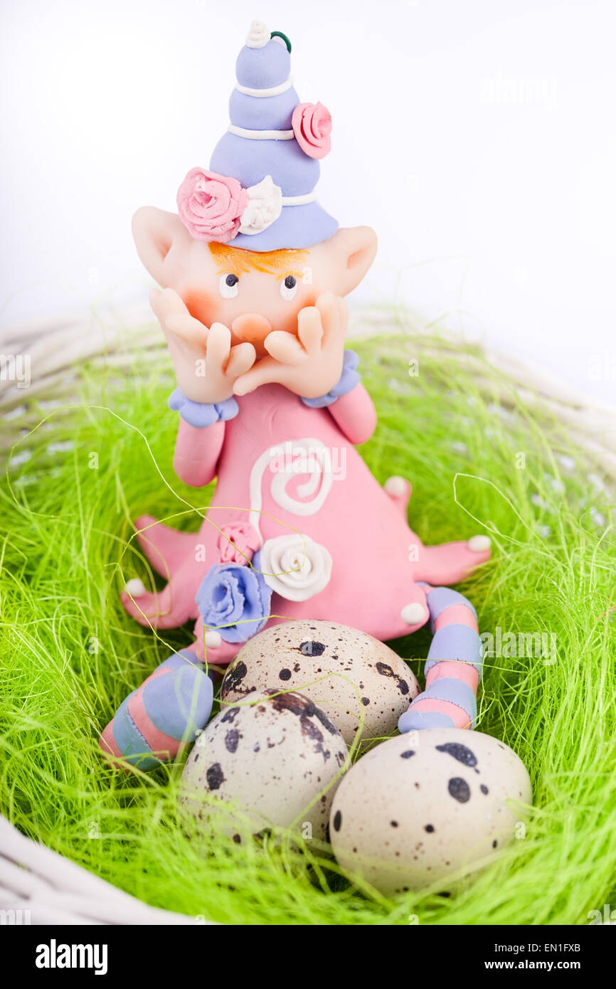 Ashamed fairy on the nest with quail eggs - Stock Image