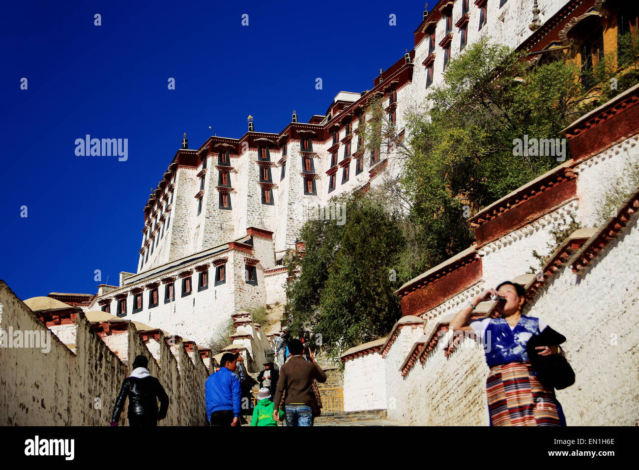 LHASA, TIBET, CHINA - OCTOBER 20: Tibetans climb the stairs leading to the inner Potala palace to visit the monument.Lhasa - Stock Image