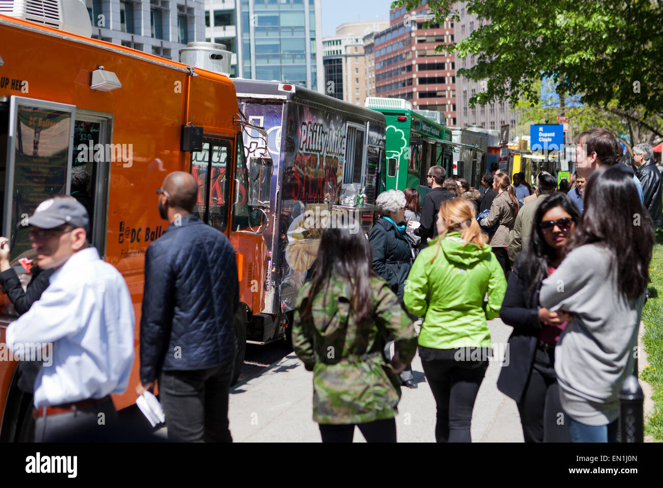 Food trucks line up on an urban street  - Washington, DC USA - Stock Image