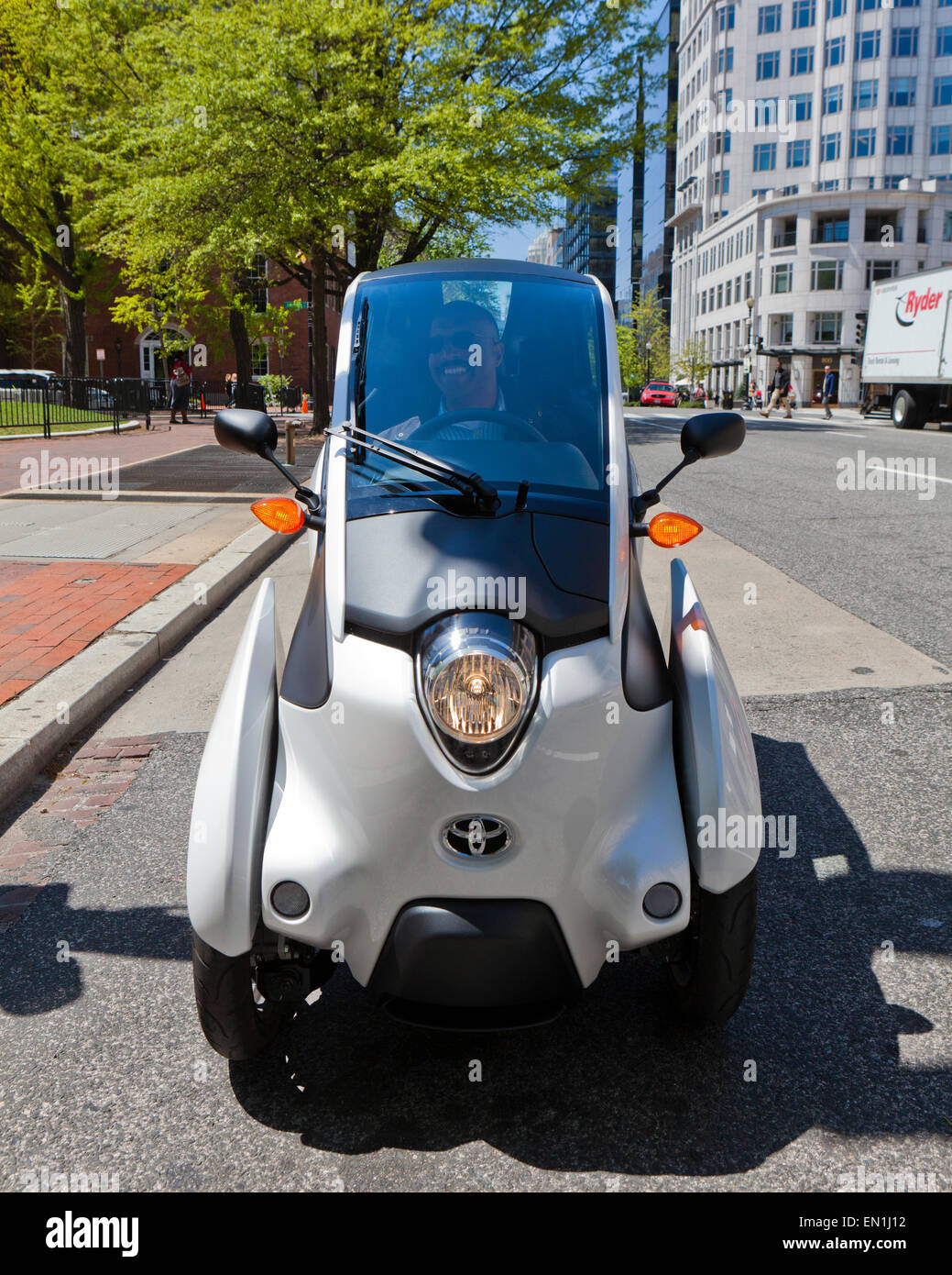 Toyota i-Road concept car (3 wheeled EV) on road - Washington, DC USA - Stock Image