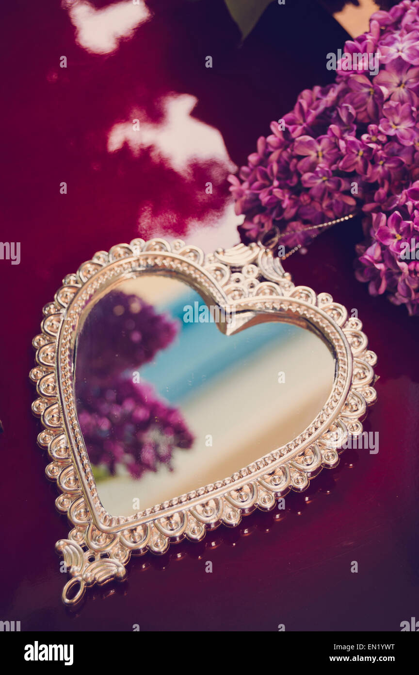 Elegant Heart Shaped Mirror With Silver Frame And Lilac Flowers On Stock Photo Alamy