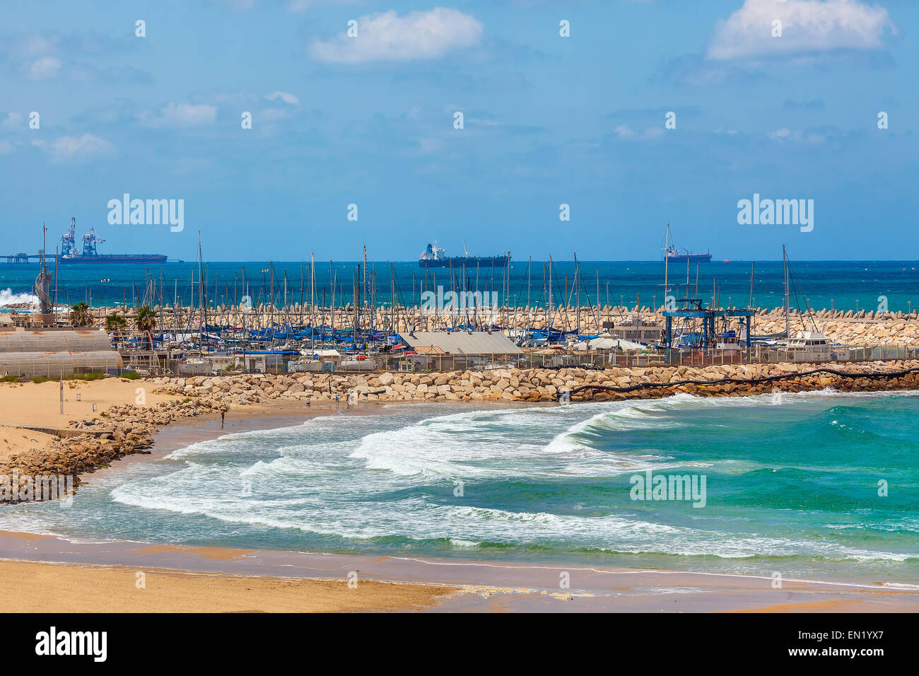 View on wavy Mediterranean sea, shoreline and marina on background on summer day in Ashqelon, Israel. - Stock Image