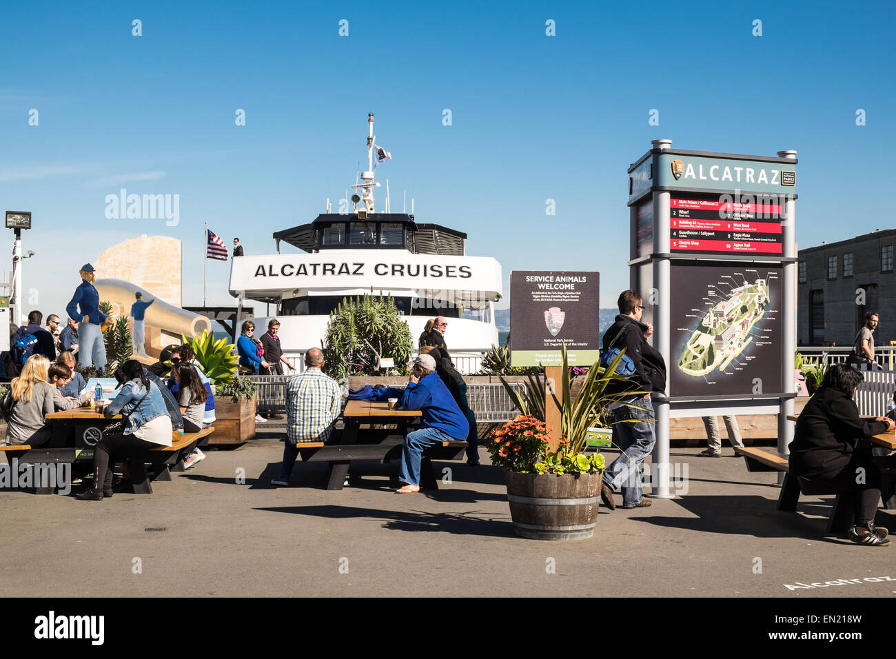 Waiting area on the key side for Alcatraz cruises with people in the foreground of the ferry boat to Alcatraz island - Stock Image