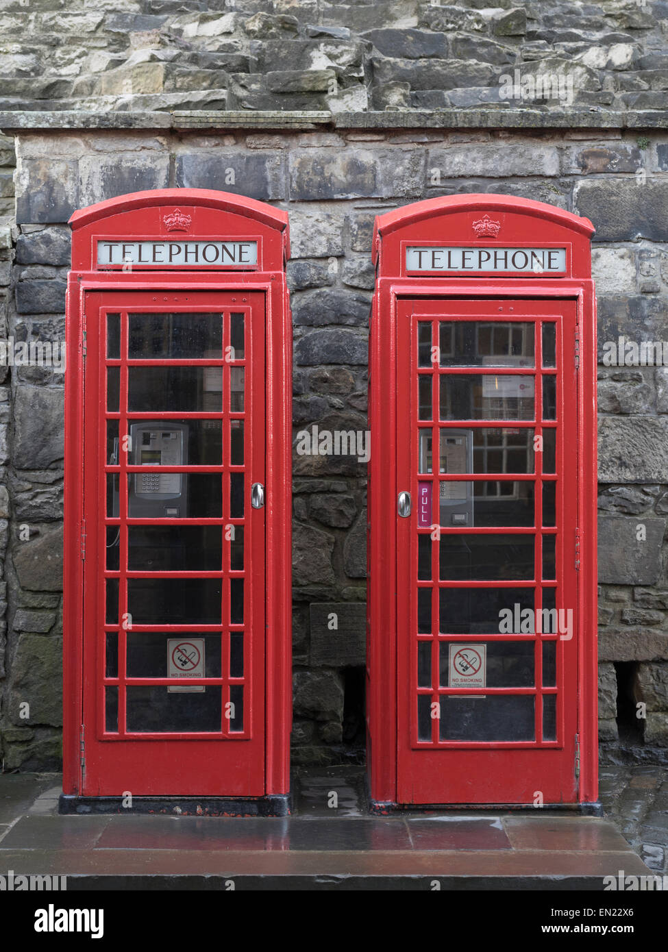 The red telephone box, a telephone kiosk for a public telephone designed by Sir Giles Gilbert Scott - Edinburgh - Stock Image