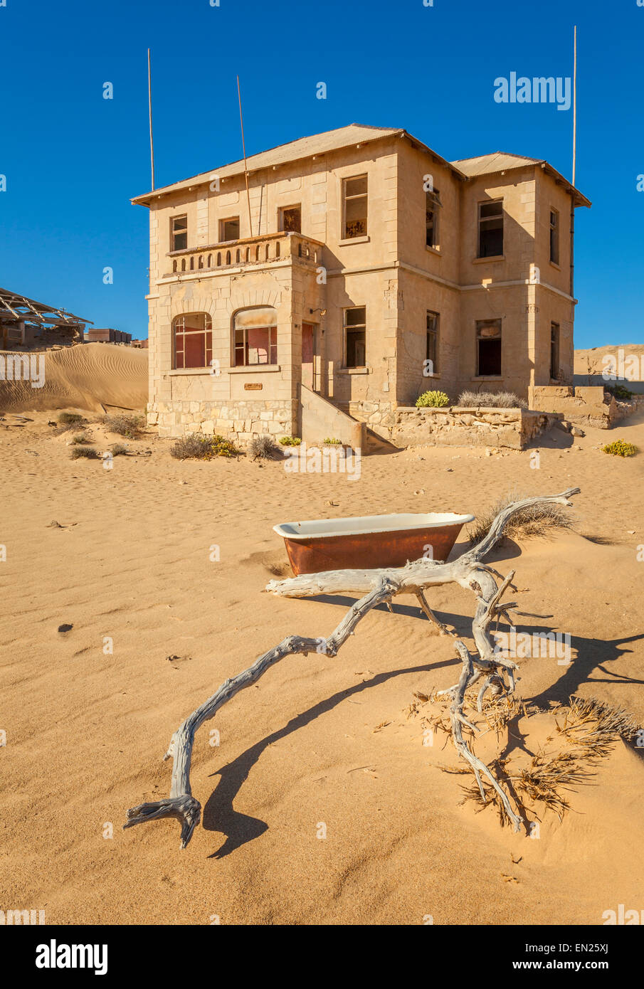 A deserted house in Kolmanskop, a former diamond town in Namibia. Stock Photo