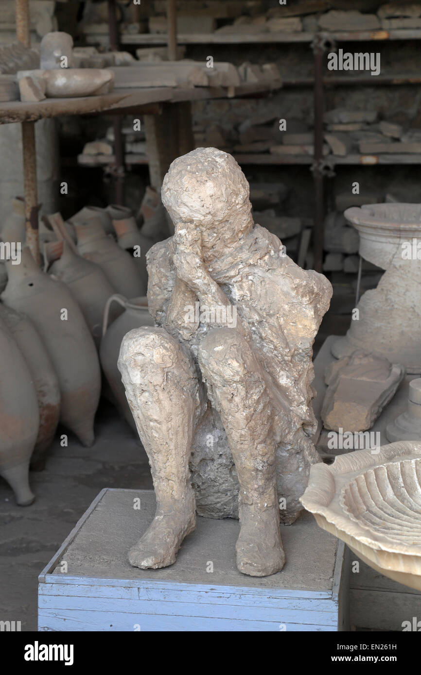 Crouched body plaster cast in the Granary, Pompeii, Italy. Stock Photo