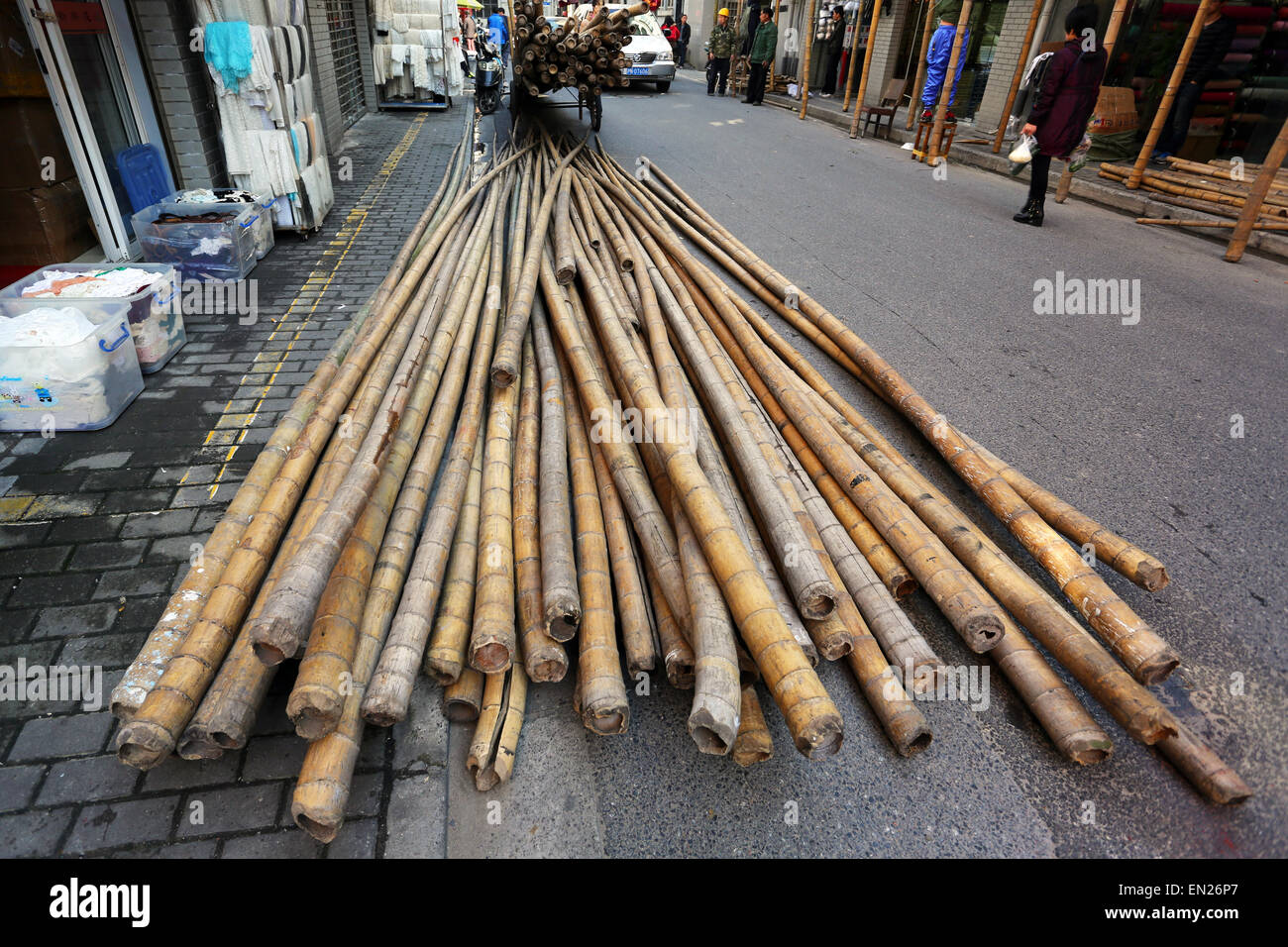 Bamboo scaffolding poles used for building and construction, Shanghai, China - Stock Image