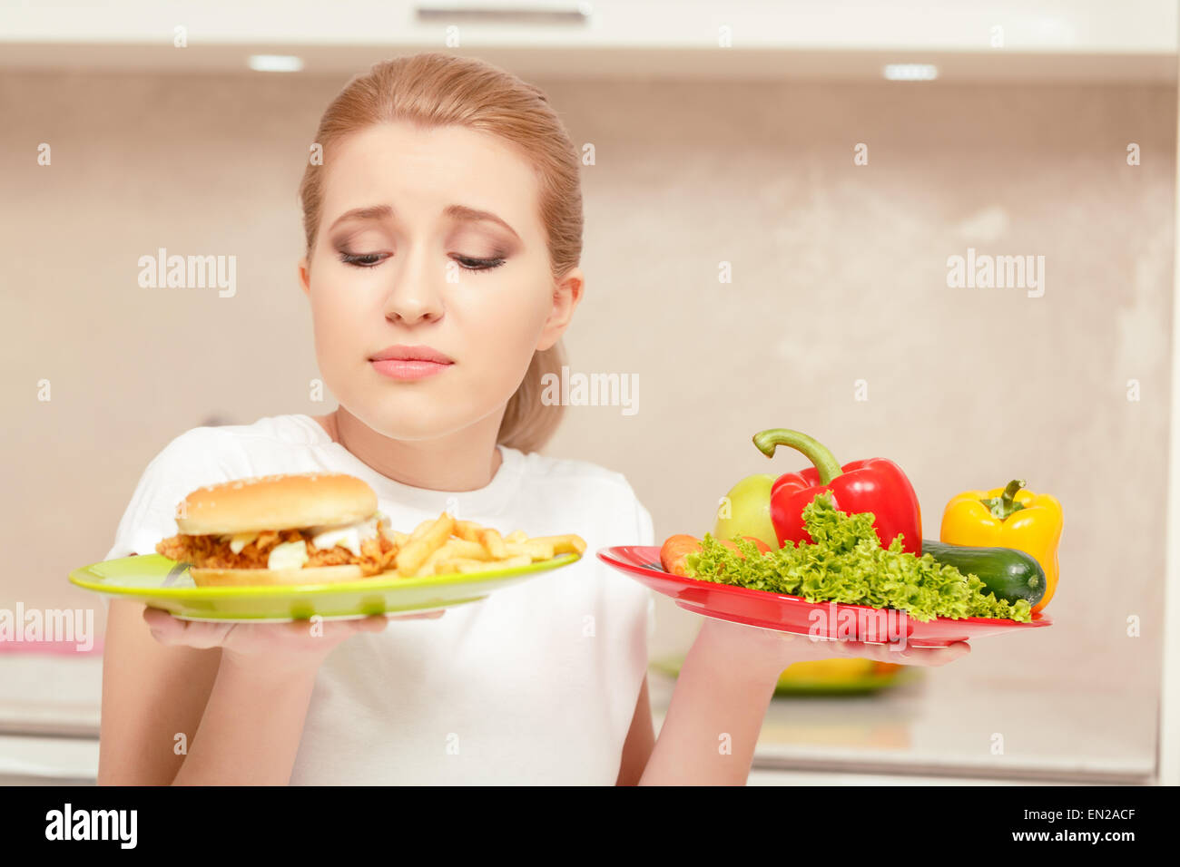 Young woman choosing lunch - Stock Image