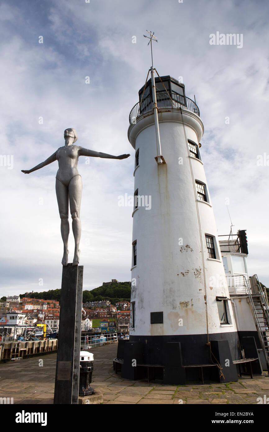 UK, England, Yorkshire, Scarborough, Vincent's Pier, Diving Belle sculpture by lighthouse - Stock Image