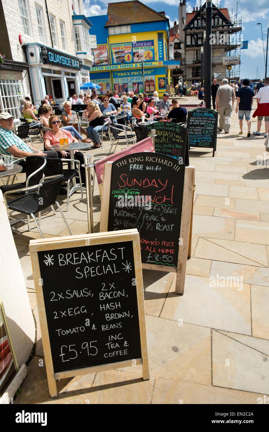 UK, England, Yorkshire, Scarborough, Sandside, chalkboard menus outside seafront cafes - Stock Image
