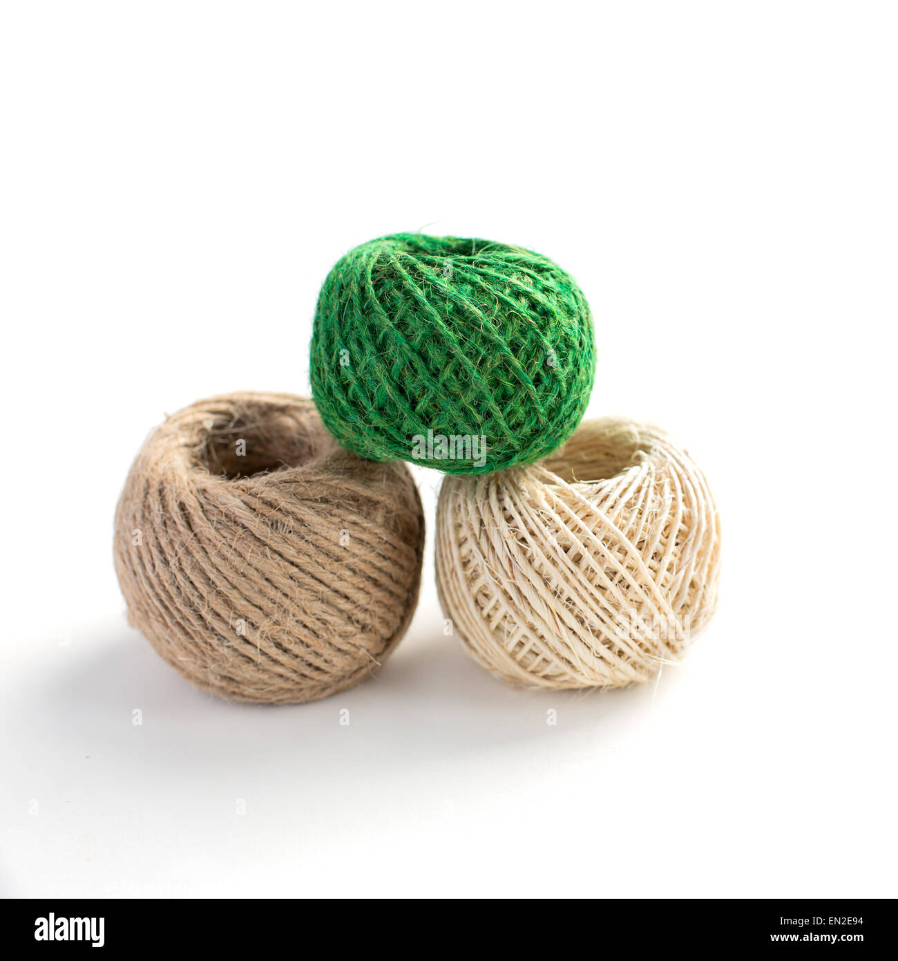 Three isolated skeins of thread for handcraft - Stock Image