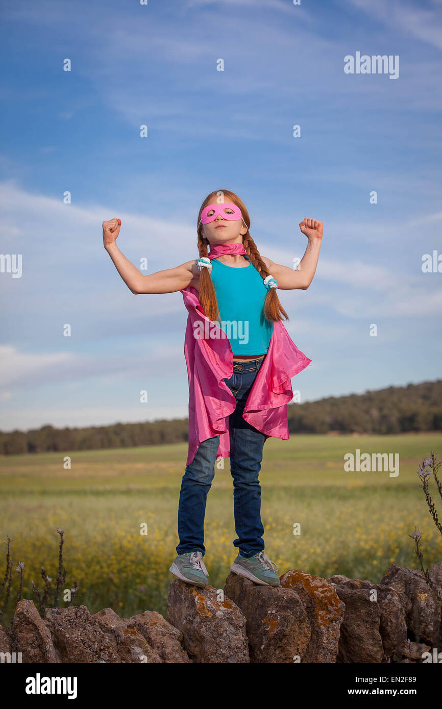 strong confident super hero girl child concept - Stock Image
