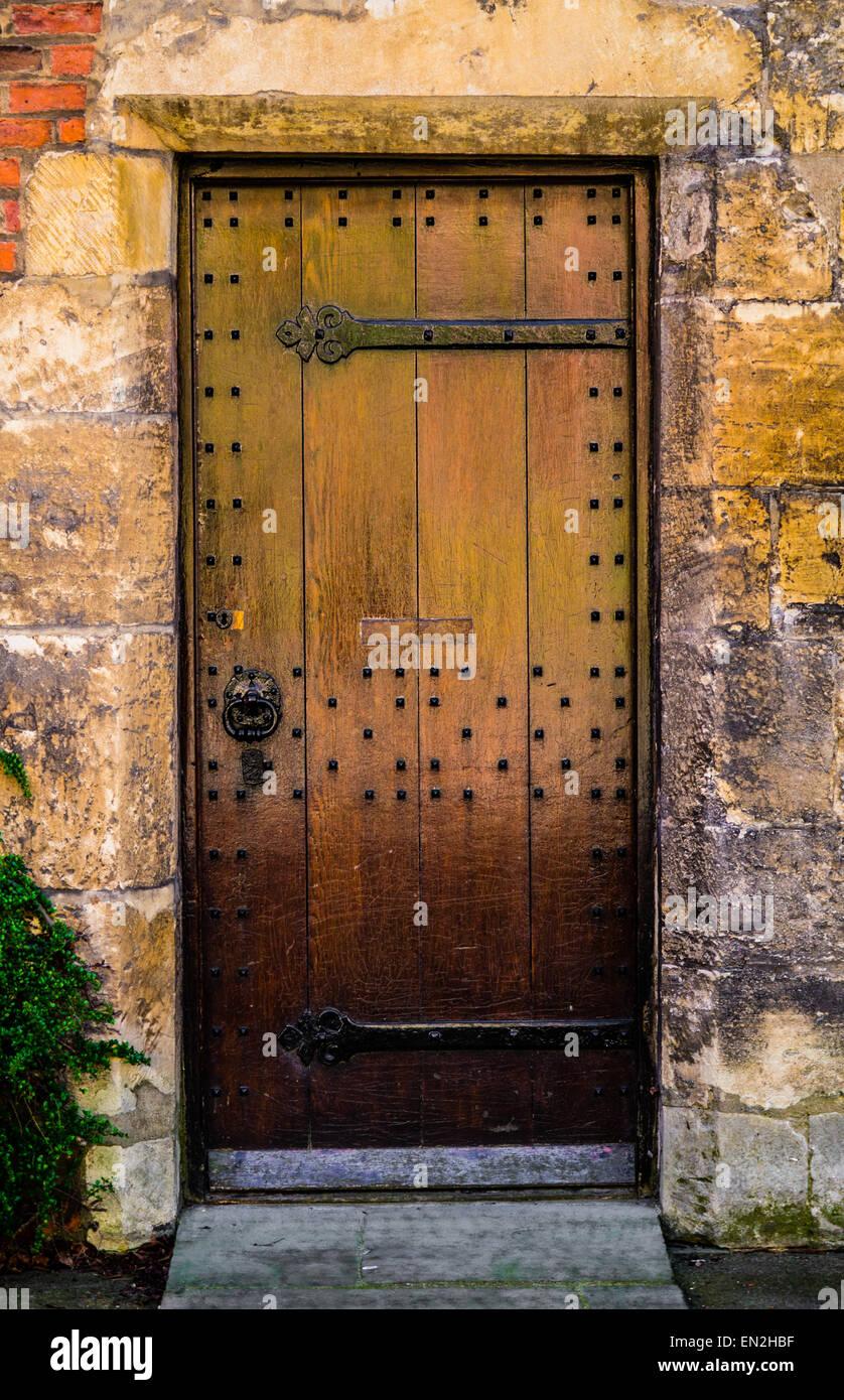 Medieval Wooden Door Against Stone Block Background Stock