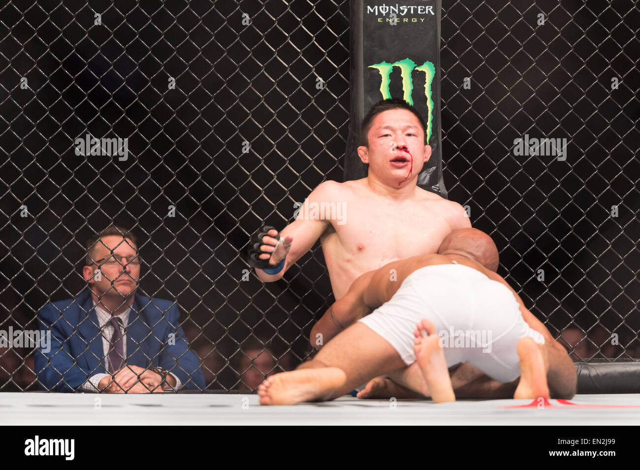 Montreal, Quebec, Canada. 25th Apr, 2015. DEMETRIOUS ''Mighty Mouse'' JOHNSON dominates KYOJI HORIGUCHI - Stock Image