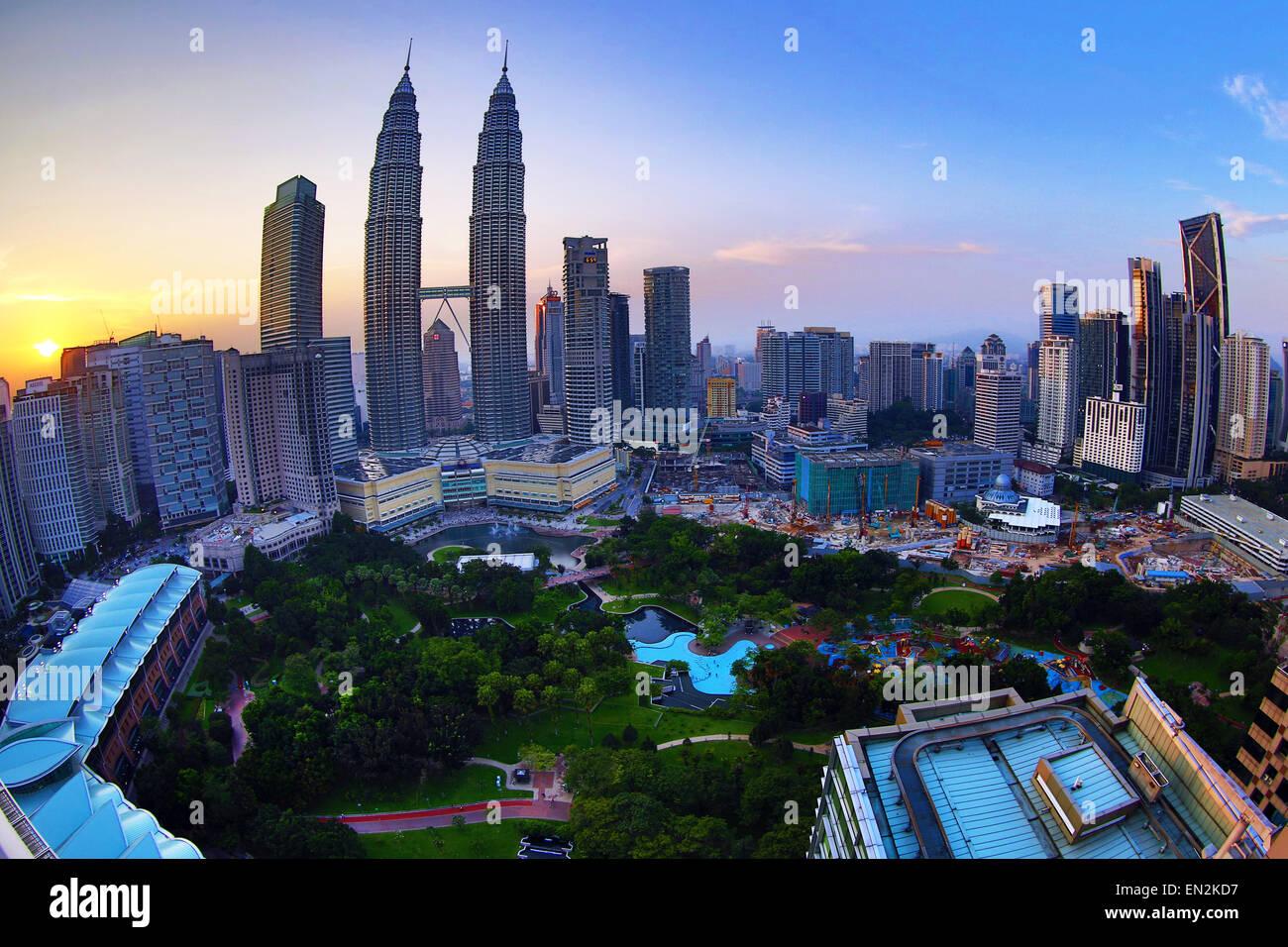 Petronas Twin Towers skyscrapers at sunset, KLCC, Kuala Lumpur, Malaysia - Stock Image