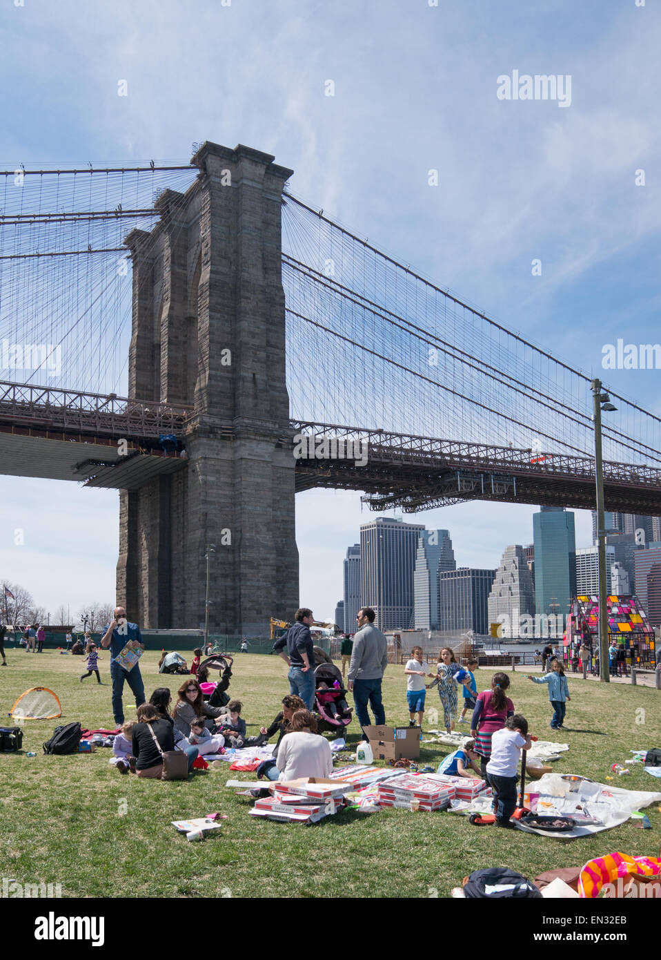 Family picnic Brooklyn Bridge park, NYC, USA - Stock Image