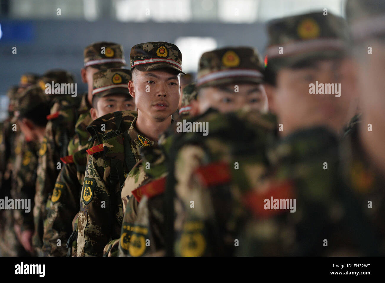 Lanzhou, China's Gansu Province. 27th Apr, 2015. Soldiers prepare to board a train at Lanzhou West Railway Station - Stock Image