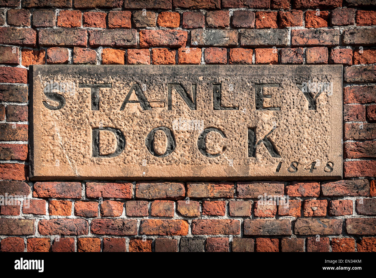 A stone sign on the wall of the historic Stanley Dock tobacco warehouse, Liverpool. Stock Photo