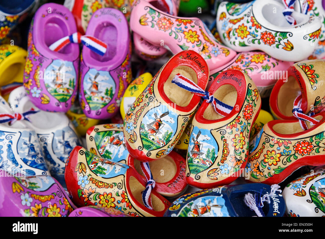 Colourful wooden Dutch shoes with windmill motif, souvenirs, province of North Holland, The Netherlands - Stock Image