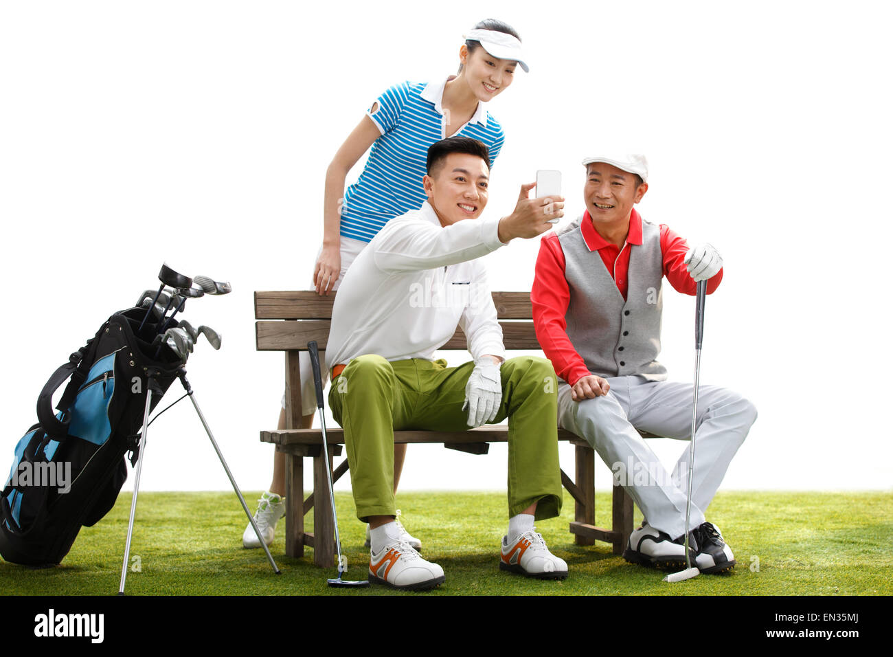 The golfer to take pictures in the grass - Stock Image