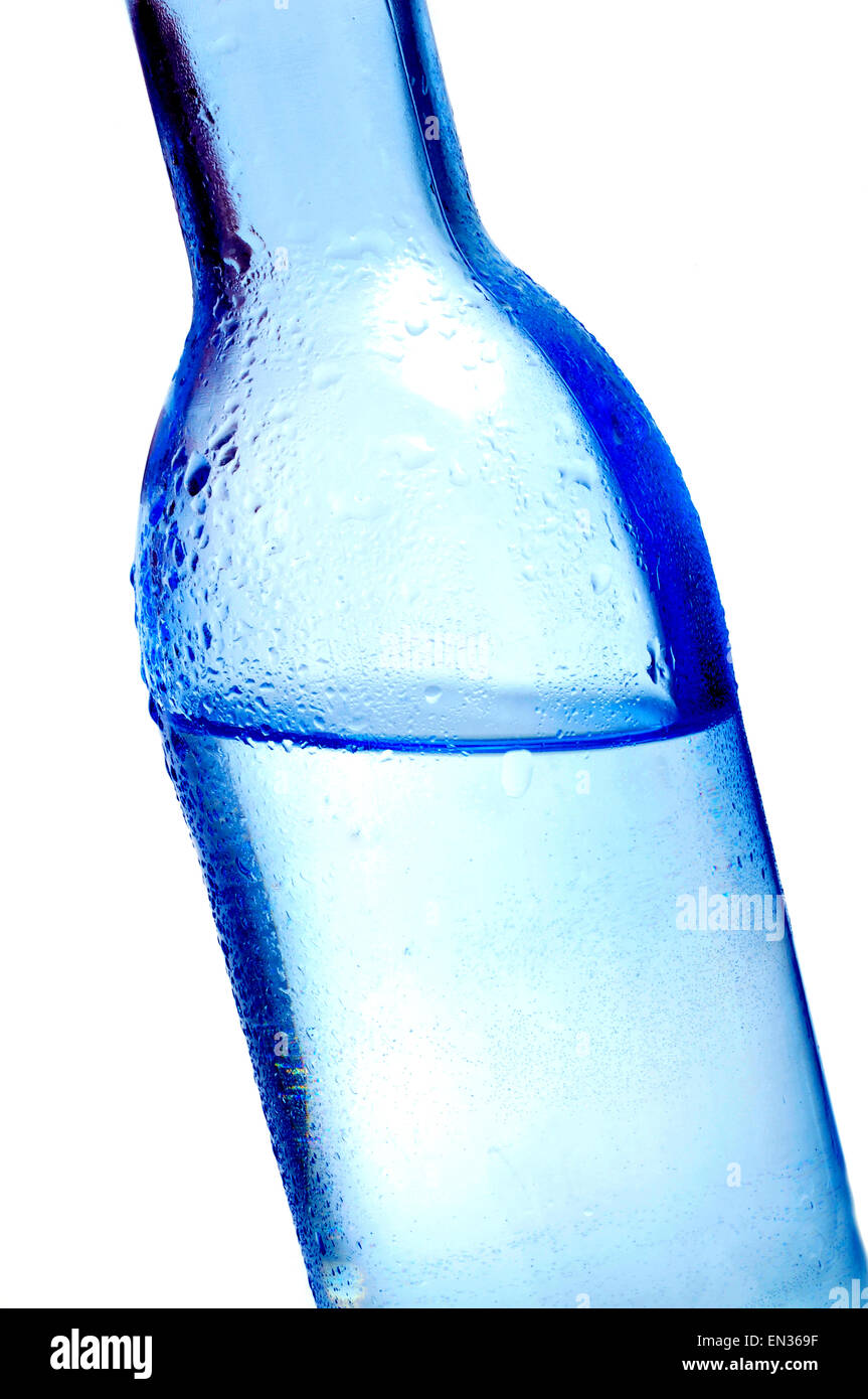 closeup of a bottle of water on a white background - Stock Image