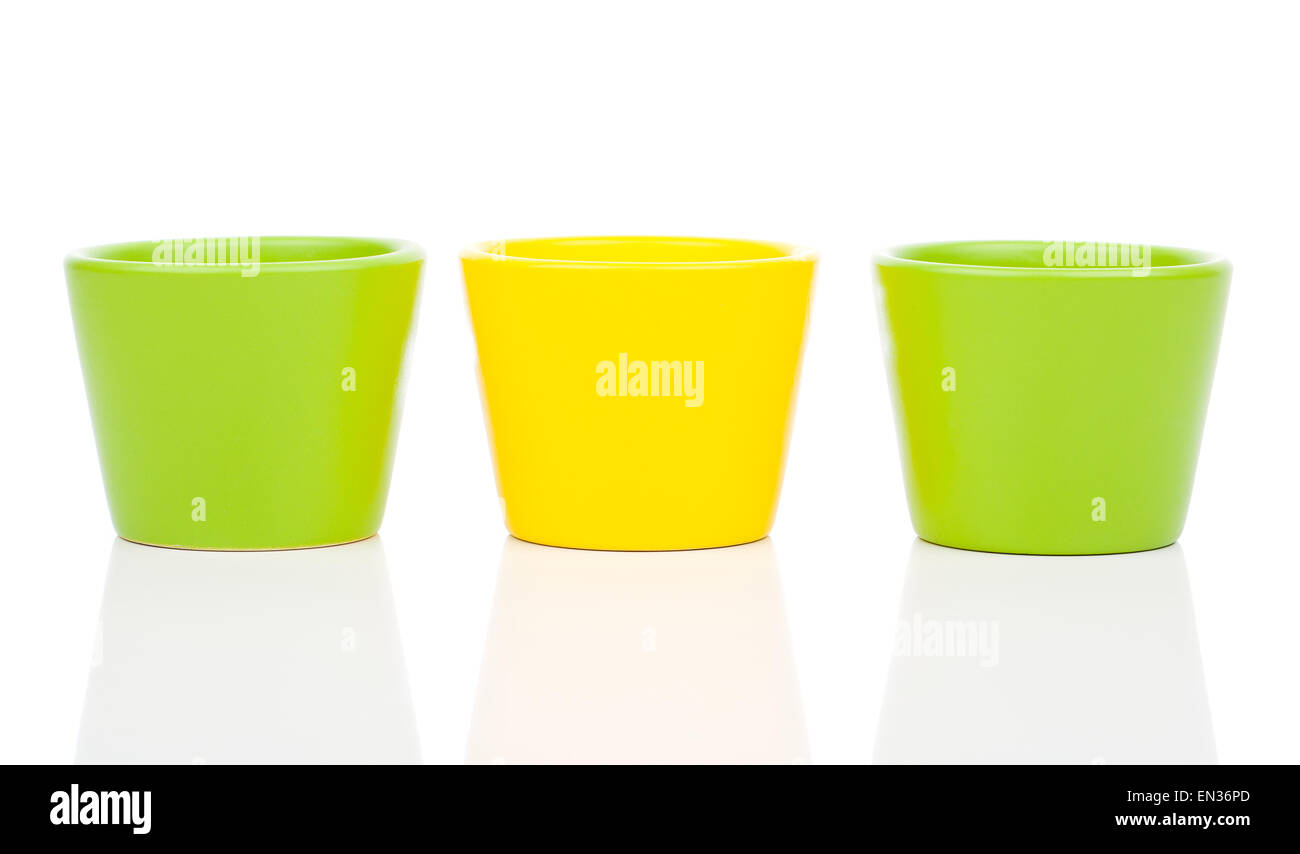 Group Of Empty Ceramic Flower Pots Isolated On White Background