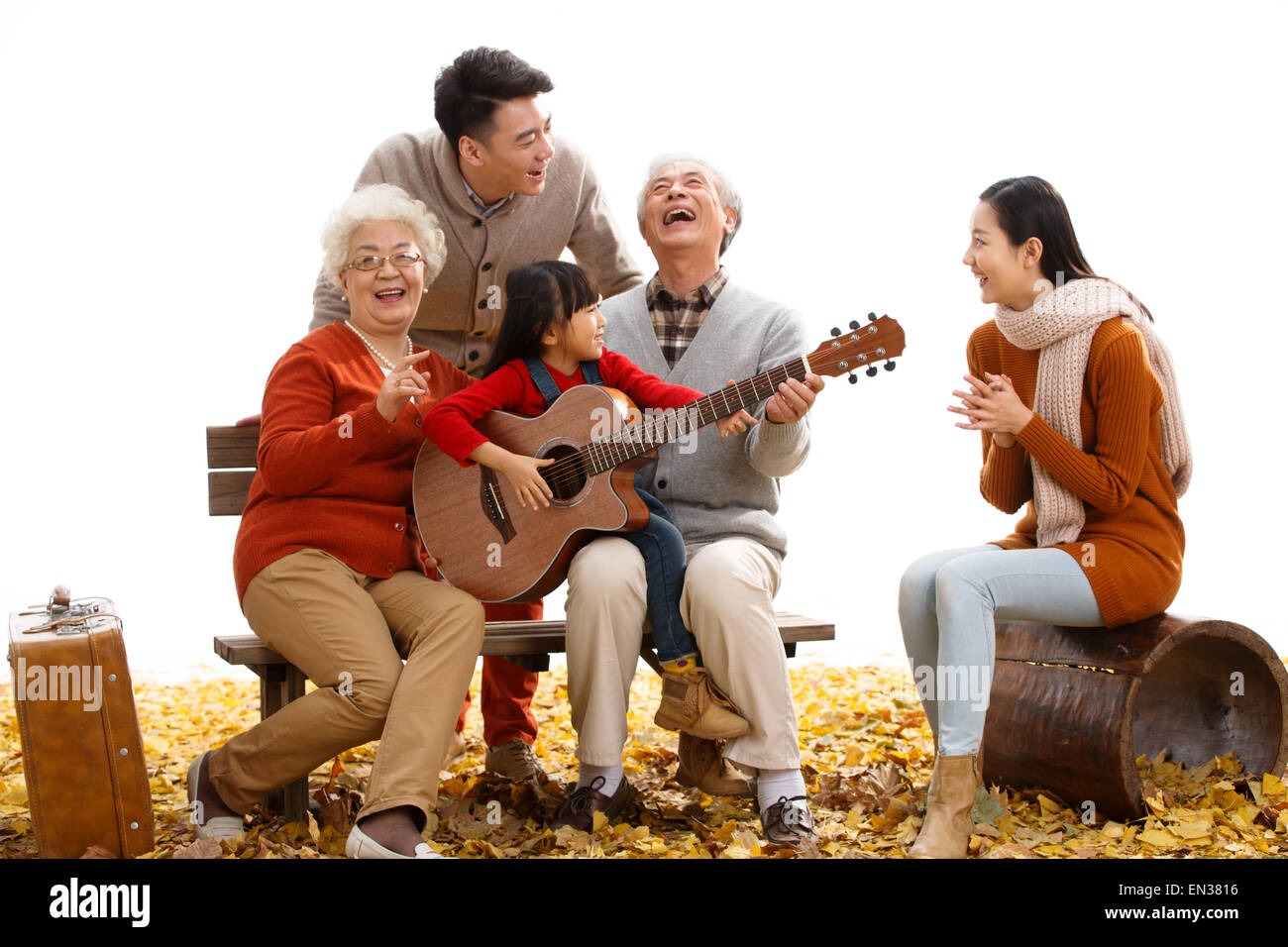 Happy family play outdoors Stock Photo