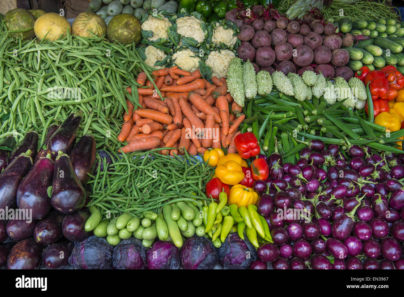 Market stall with okra, cauliflower, beets, carrots, eggplant, cucumbers, peppers, Mattancherry, Kochi, Cochin, Kerala, India Stock Photo