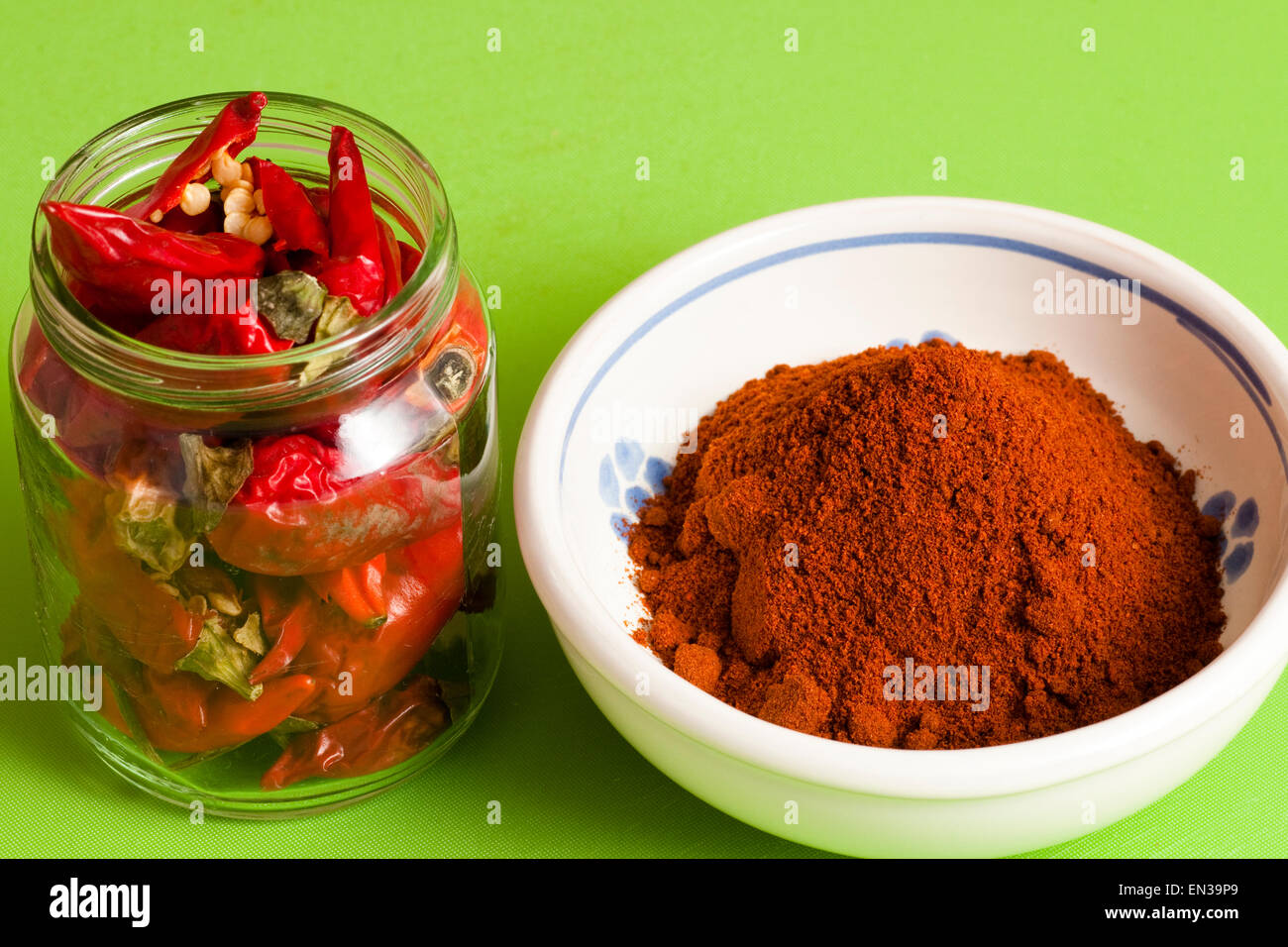 red hot chili peppers whole and ground - Stock Image