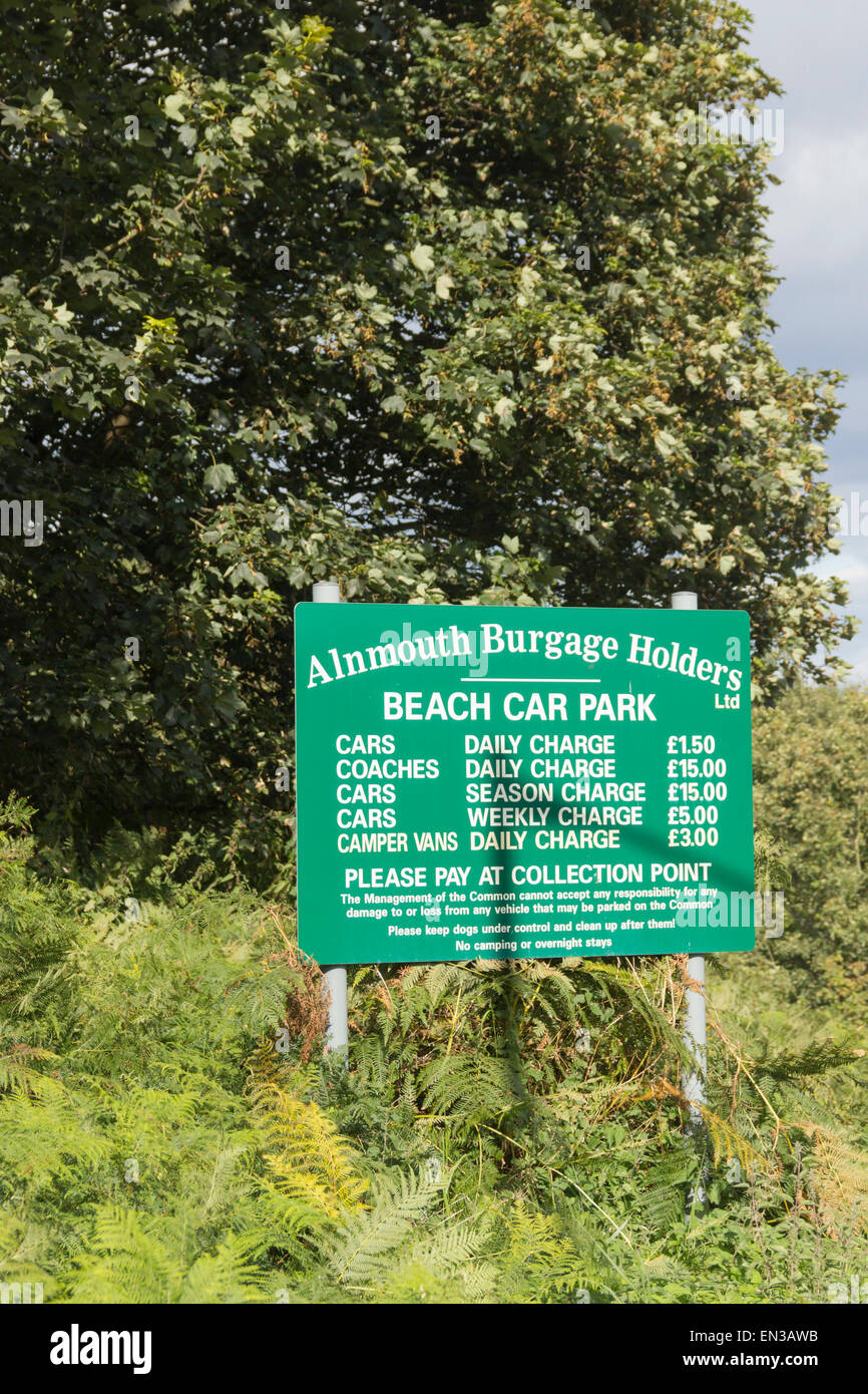 Beach car park charges sign at Alnmouth, Northumberland. - Stock Image