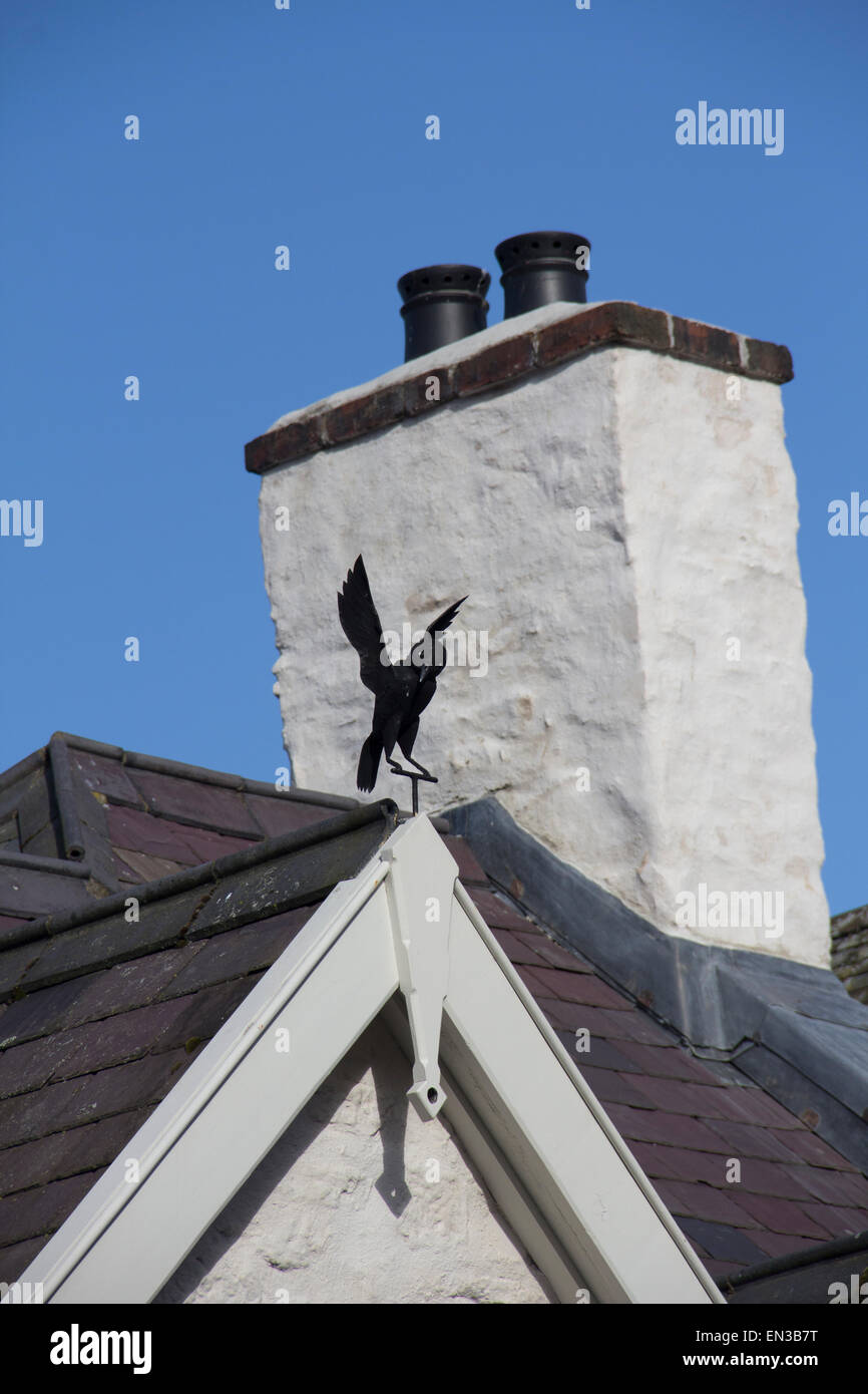 One of three metal Jackdaws on the gables of the former Black Lion pub (aka the Brickdall building) in Castle Street, - Stock Image