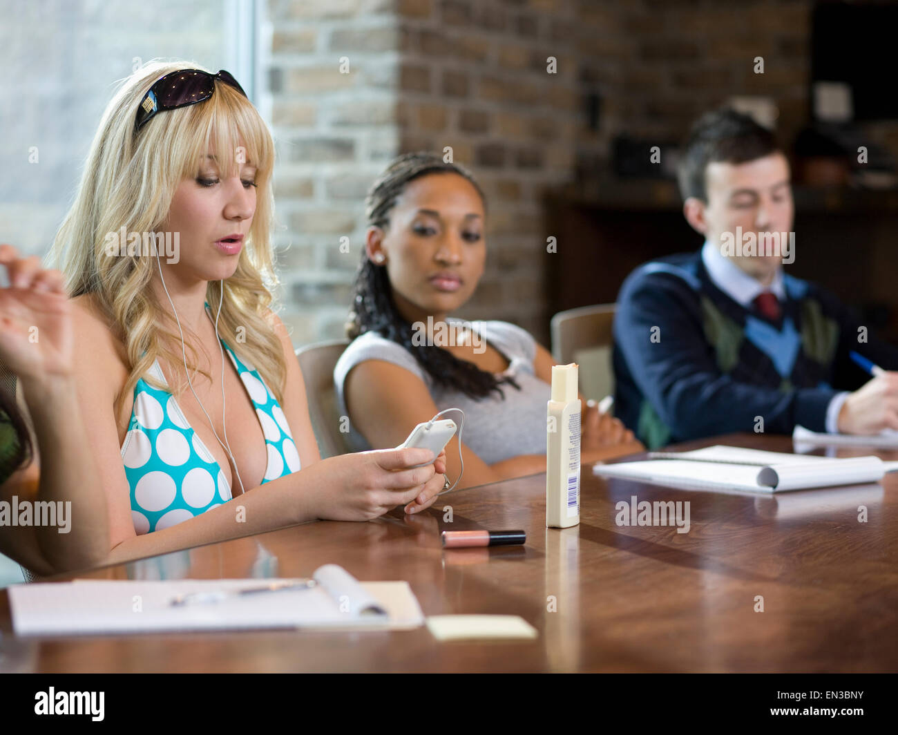 woman in a bikini at work - Stock Image
