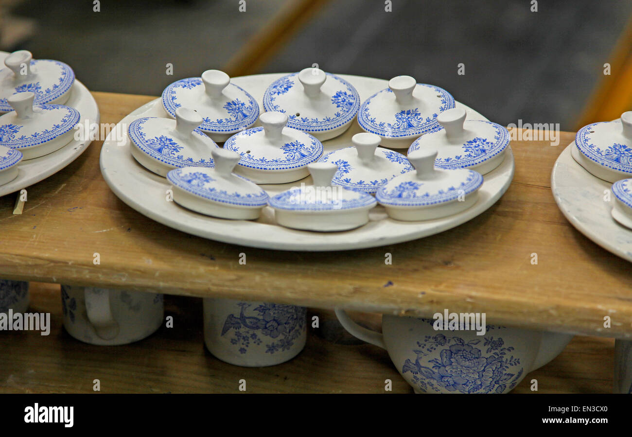Teapot lids at the Burleigh Middleport pottery factory Stoke-on-Trent North Staffordshire England UK & Teapot lids at the Burleigh Middleport pottery factory Stoke-on ...