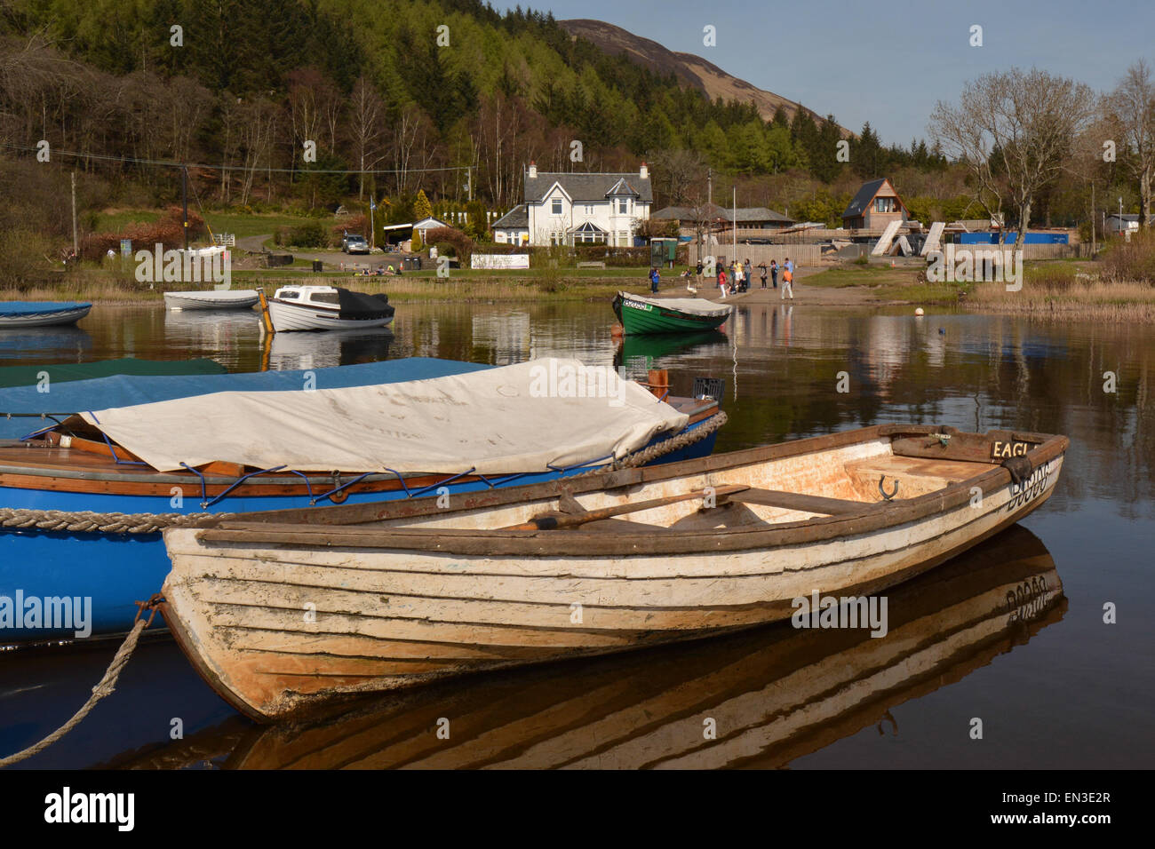BALMAHA, LOCH LOMOND, SCOTLAND, UK - 22 APRIL 2015: Balmaha marina viewed from Balmaha boatyard on warm spring day - Stock Image
