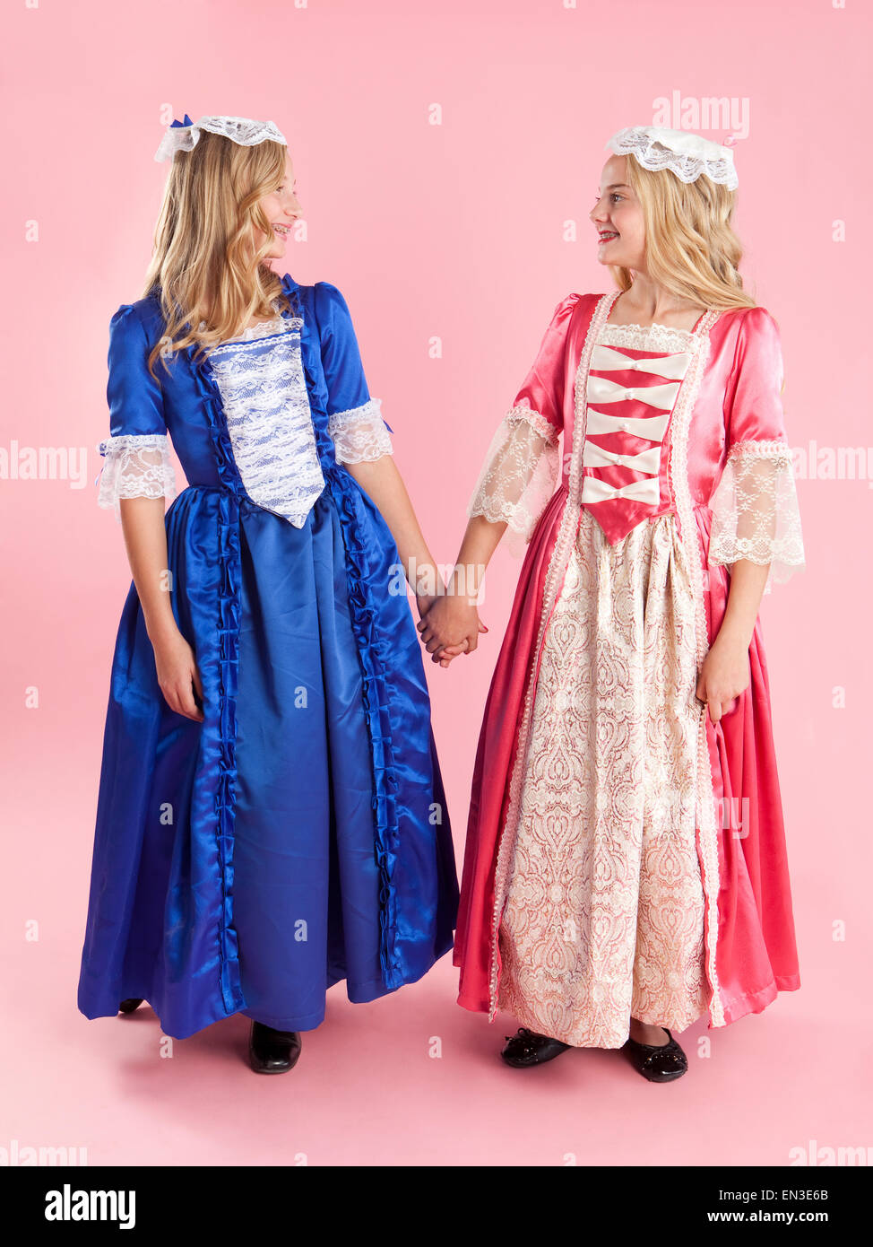 Two girls (10-11) in colonial princess dresses for Halloween - Stock Image