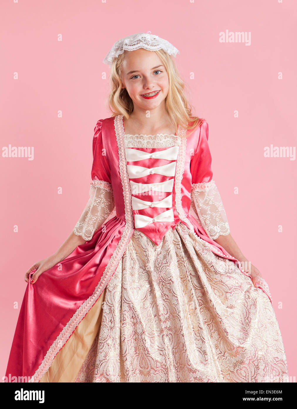 Portrait of girl (10-11) in colonial princess dress for Halloween - Stock Image