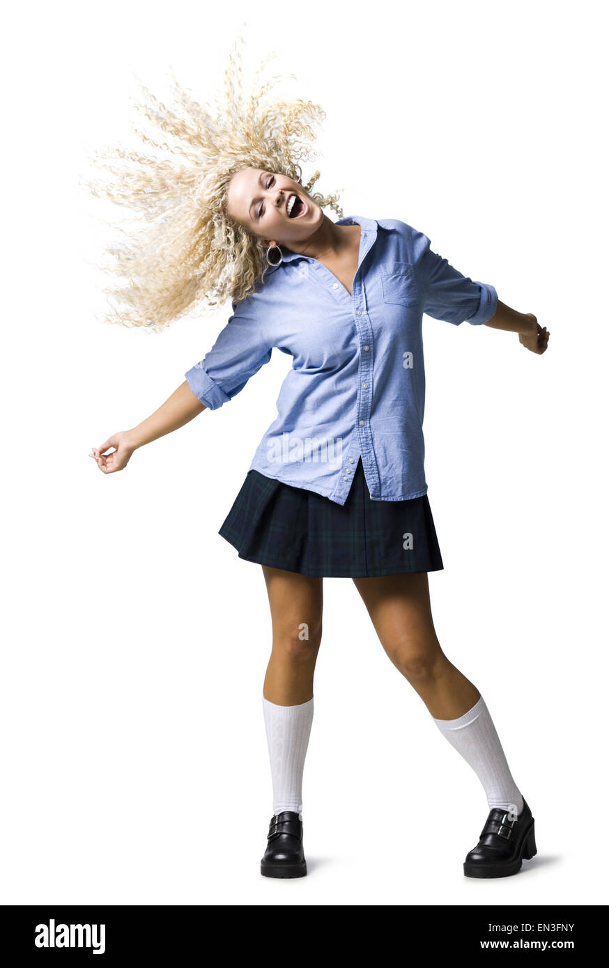 woman in a school girl outfit - Stock Image