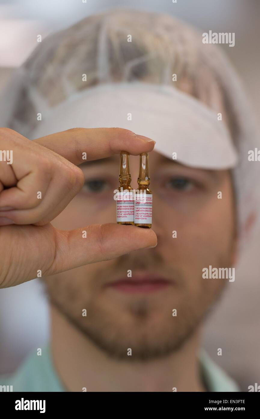 Jena, Germany. 27th Apr, 2015. Line manager Stefan Rissland holds two ampoules filled with cerebrolysis for the - Stock Image