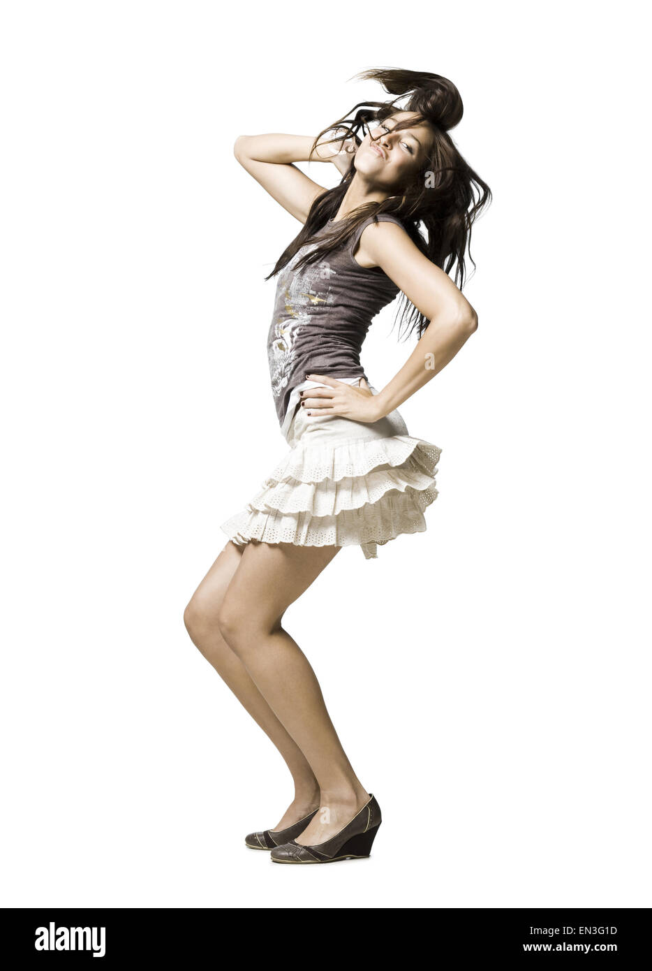 woman in a skirt dancing - Stock Image