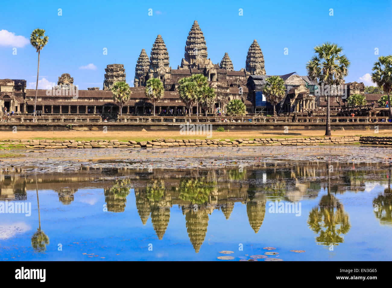 Ancient temple Angkor Wat from across the lake. The largest religious monument in the world. Siem Reap, Cambodia - Stock Image
