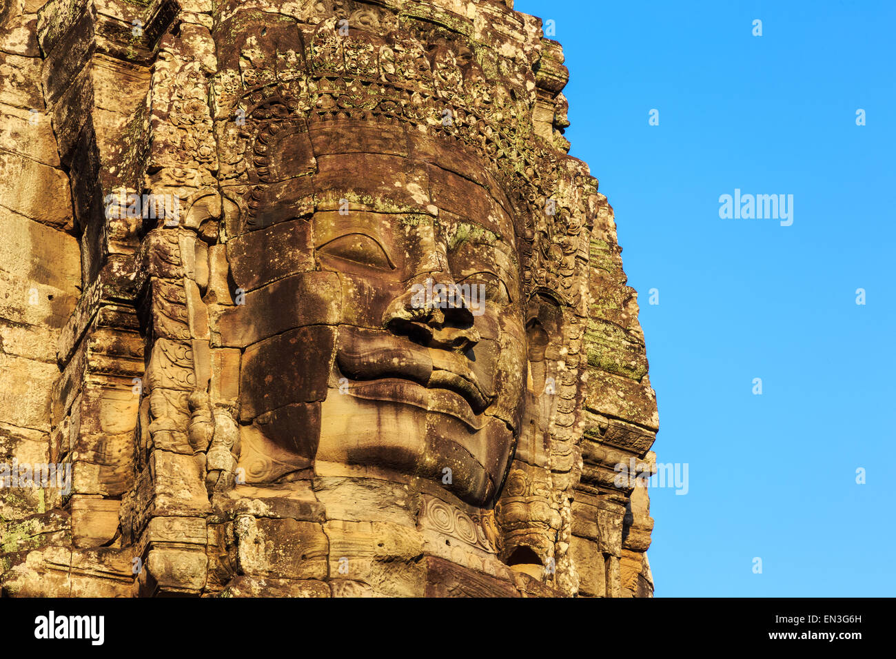 Stone face towers of Bayon Temple at ancient Angkor. Siem Reap, Cambodia - Stock Image