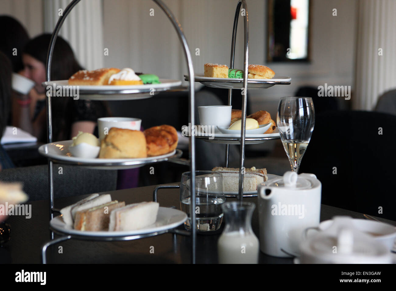 Afternoon tea, sandwiches, scones and cakes at the Blythswood Hotel in Glasgow Scotland - Stock Image