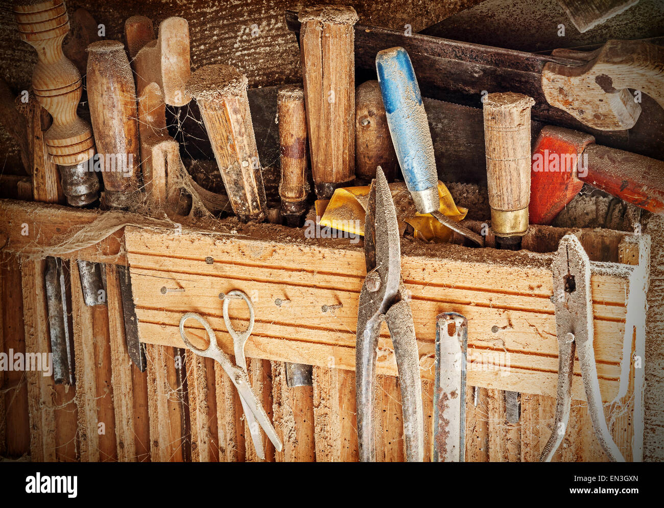 Retro filtered background made of old rusty woodworking tools. - Stock Image