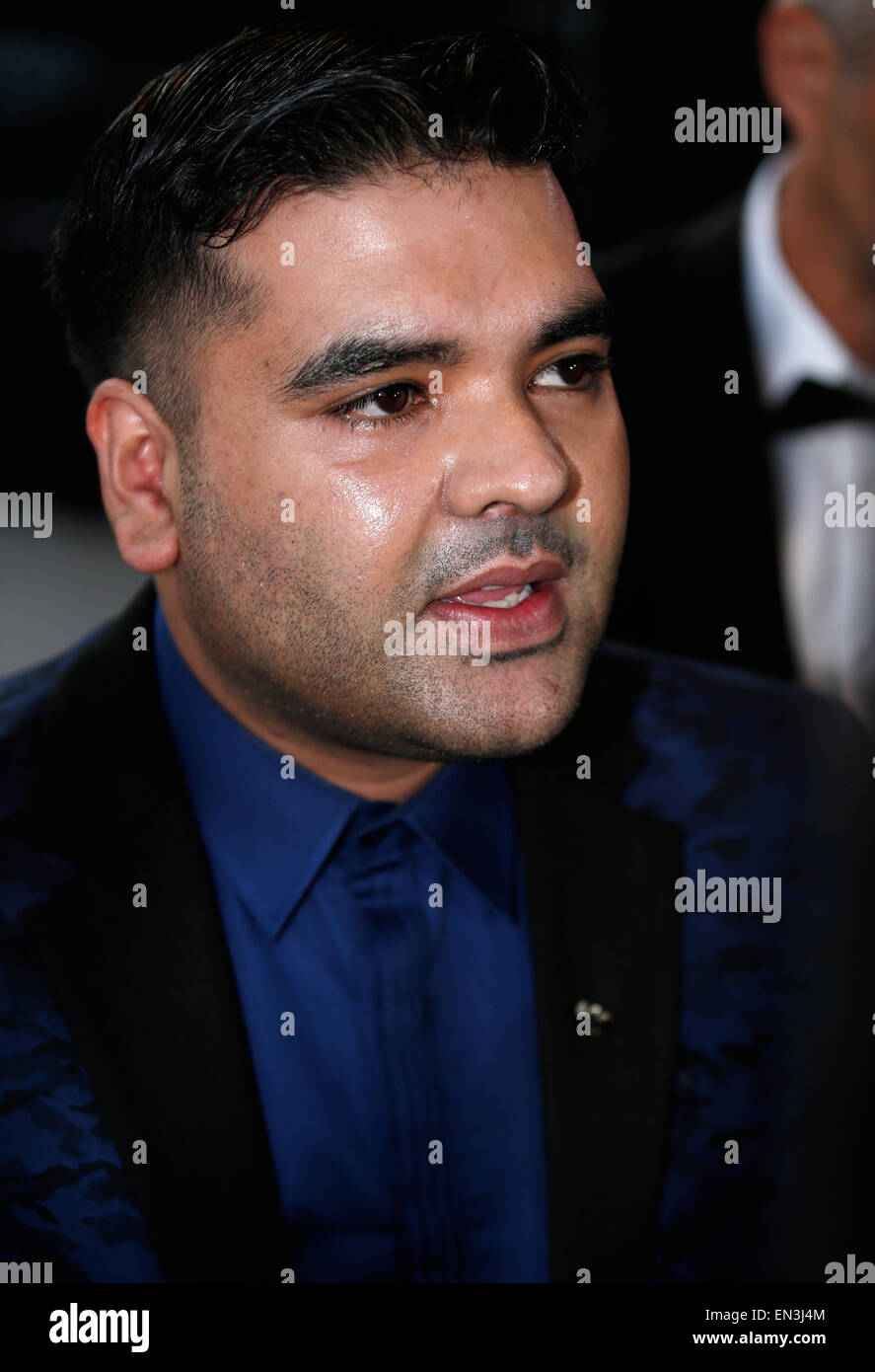 Shahid Khan, known by his stage name Naughty Boy, arrives for an award ceremony in London April 2015 Stock Photo