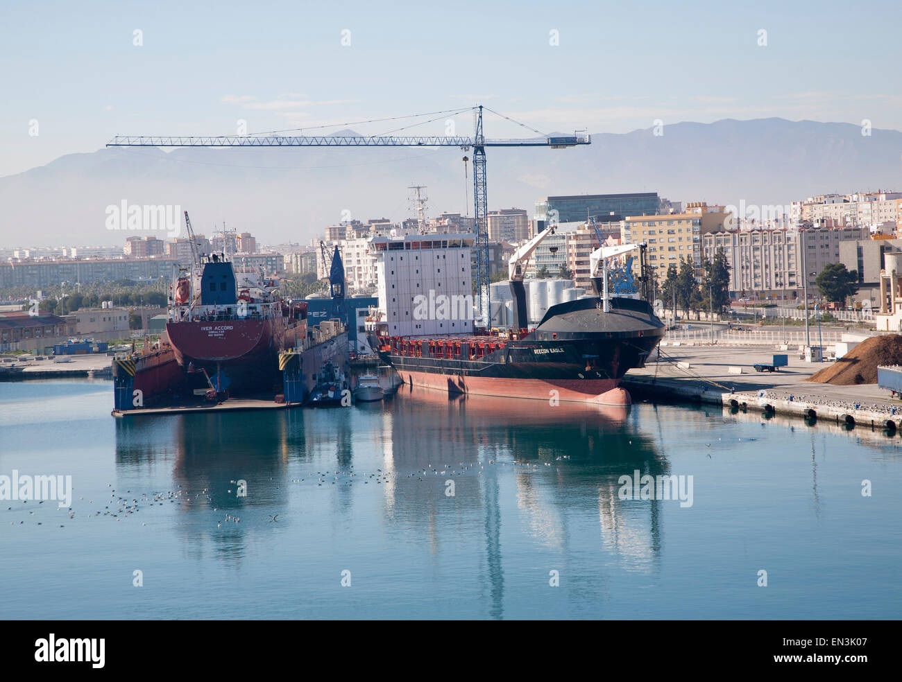 Cargo ships in the port of Malaga, Spain - Stock Image