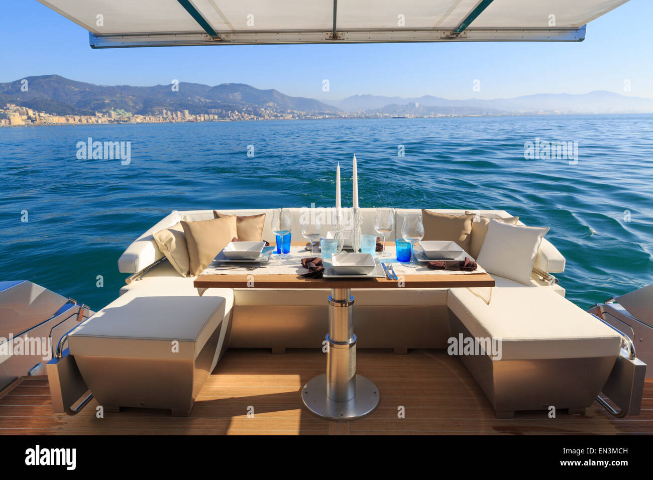 lunch on motor yacht, Table setting at a luxury yacht. - Stock Image